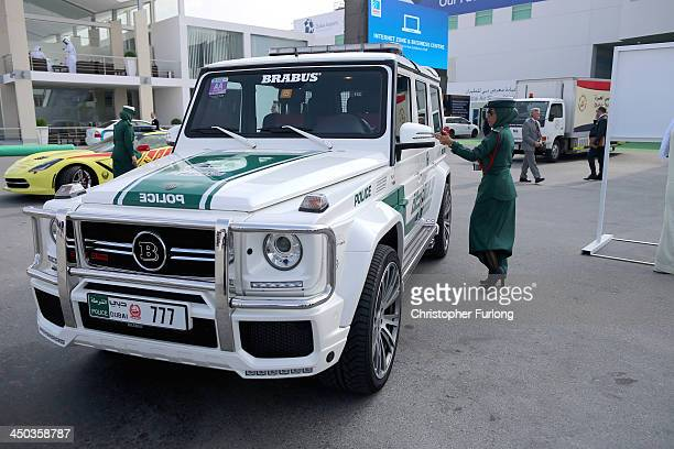 Female Emerati police officer locks her Mercedes Benz Brabus 4x4 supercar during the Dubai Airshow on November 18 2013 in Dubai United Arab Emirates...
