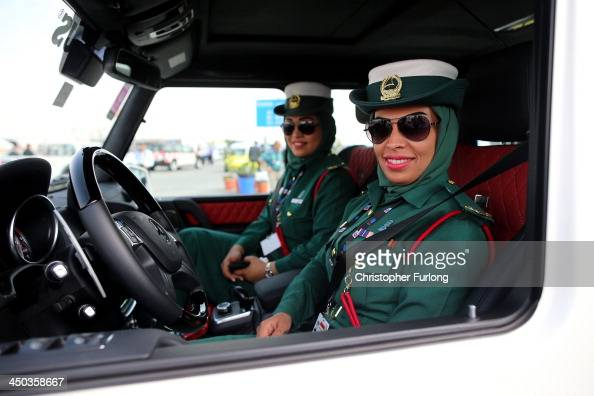 Female Emerati police officers smile as they sit inside their Mercedes Benz Brabus 4x4 supercar during the Dubai Airshow on November 18 2013 in Dubai...