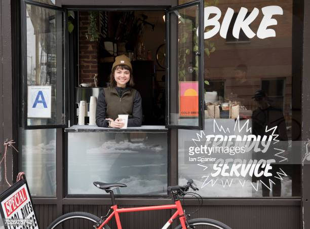 Female employee at service window, Nike and Coffee shop, New York, USA