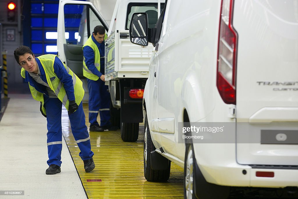 A female employee checks a completed Ford Transit van as it moves along the production line at the Ford Otosan plant, the joint venture between Ford Motor Co.'s Ford Otomotiv Sanayi AS and Koc Holding AS, in Golcuk, Turkey, on Wednesday, Nov. 20, 2013. Istanbul-based Automobile Distributors' Association, or ODD, forecasts Turkey's total automotive industry market to be between 830k and 870k this year. Photographer: Kerem Uzel/Bloomberg via Getty Images
