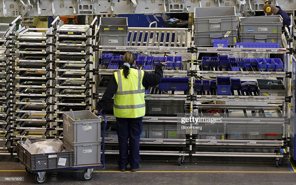 A female employee collects parts from a trolley during the manufacture of Airbus A320 single-aisle passenger aircraft wings at the company's factory in Broughton, U.K., on Monday, Feb. 4, 2013. Airbus SAS won a $9 billion order from Steven Udvar-Hazy's Air Lease Corp. that includes 25 A350 wide-body jets, a competitor to Boeing Co.'s grounded 787 Dreamliner. Photographer: Paul Thomas/Bloomberg via Getty Images