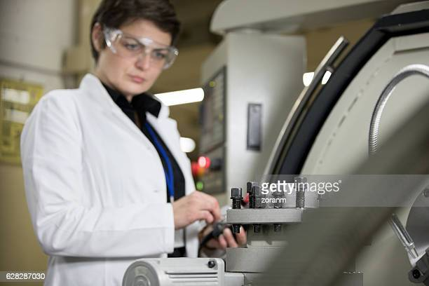 Female employee working on production line