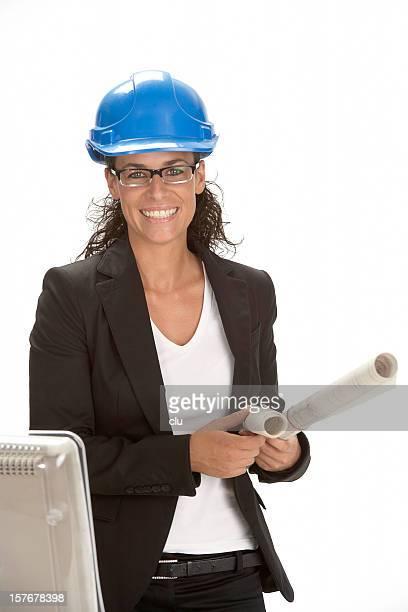 Weibliche Ingenieur Architekt am Schreibtisch auf weißem Hintergrund