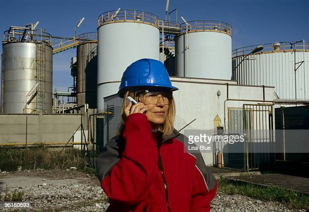 Female Engineer in front of Chemical Plant