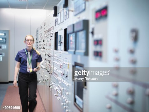 Female engineer in nuclear power station control room simulator