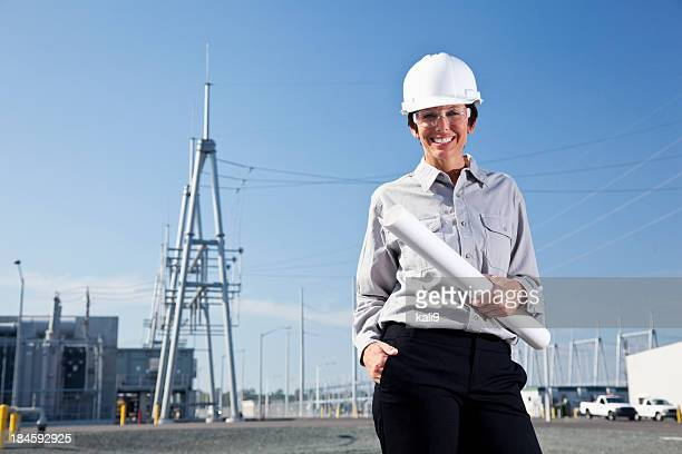Female engineer in parking lot of power station