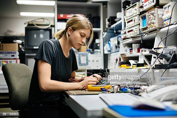Female Engineer Measuring Voltage