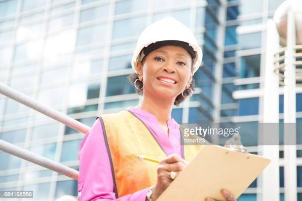 STEM Female engineer or architect working on a construction project in city.