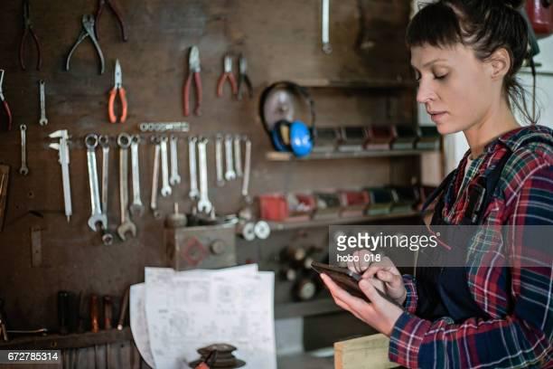 Female engineer using technology