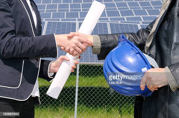 Female Engineers Handshaking in a Solar Power Station