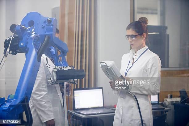 Female engineers workingin researc lab