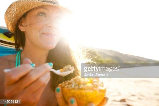 A female enjoying a day at the beach.
