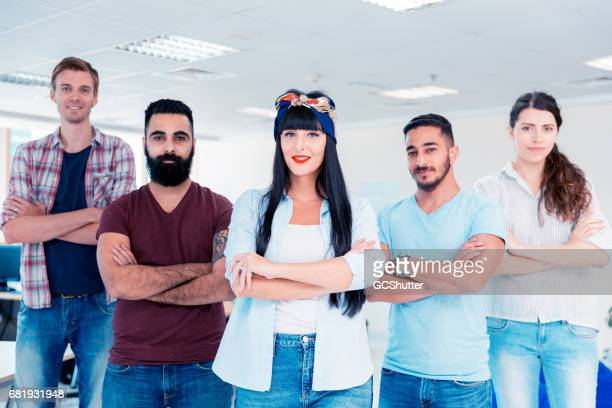 Female entrepreneur and her team at their office