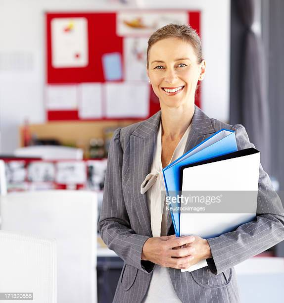 Female Executive Holding Files