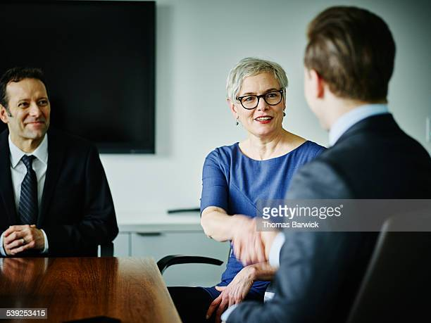 Female executive shaking hands with businessman