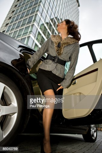 female executive stepping out of car : Stock Photo