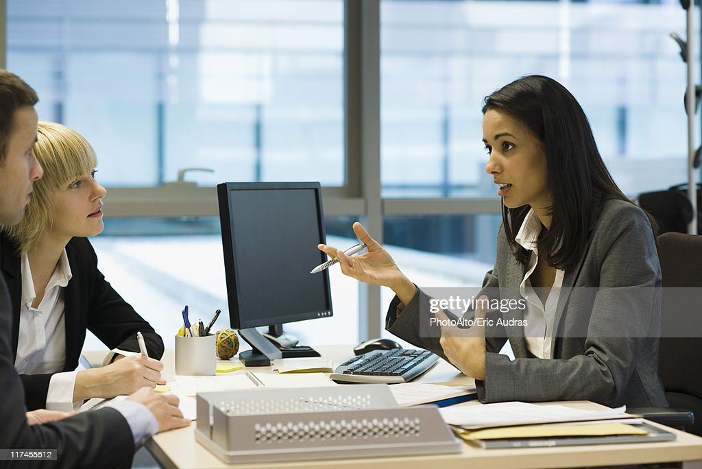 Female executive talking to colleagues