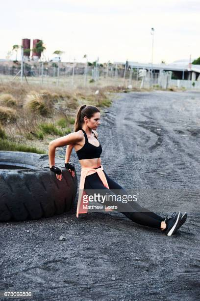 Female exercising in industrial area