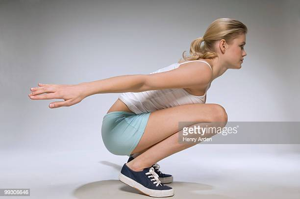 Female exercising in studio