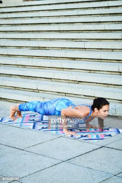 Female exercising in urban area