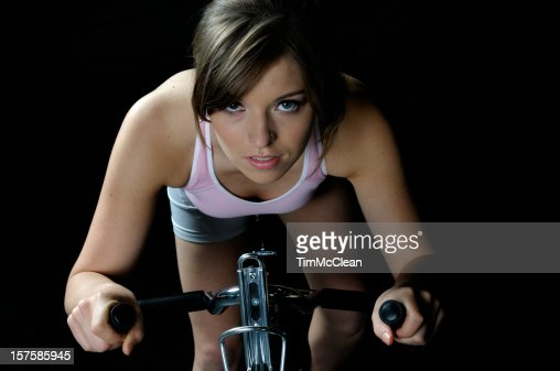 Female exercising on a bike