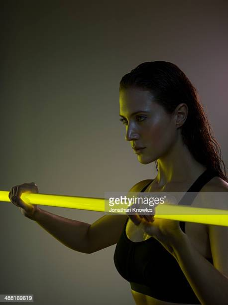Female exercising with a neon light stick
