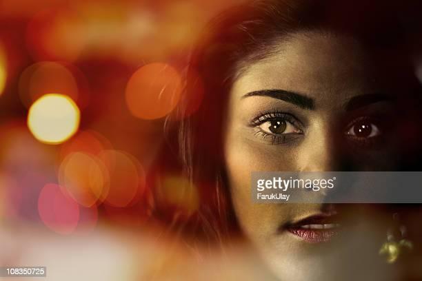 Female Face among Sparkling Lights