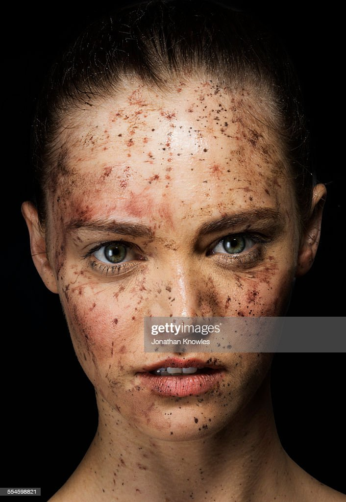 Female face covered in dirt