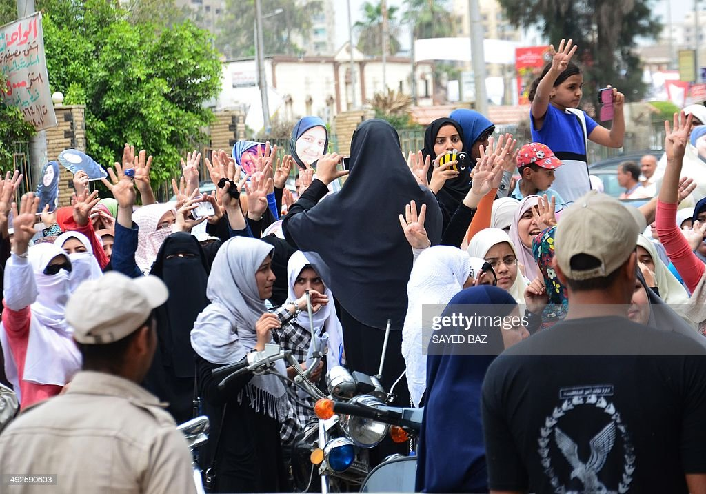 Female family members some flashing the four finger symbol known as 'Rabaa' meaning four in Arabic which is associated with those killed in the...