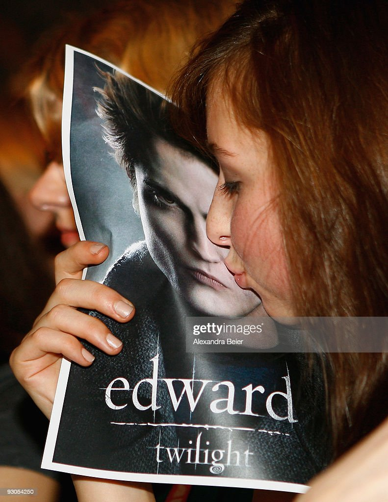 A female fan kisse sa poster showing the face of actor <a gi-track='captionPersonalityLinkClicked' href=/galleries/search?phrase=Robert+Pattinson&family=editorial&specificpeople=734445 ng-click='$event.stopPropagation()'>Robert Pattinson</a> before the presentation of his new film 'The Twighlight - New Moon' at an HVB youth event at the Olympic Hall on November 14, 2009 in Munich, Germany.