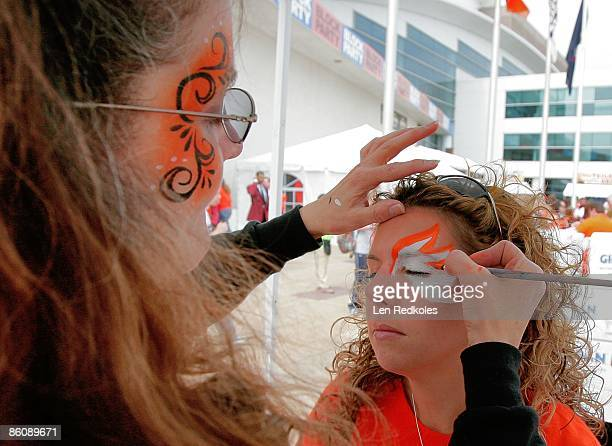 A female fan of the Philadelphia Flyers has her face painted at a block party prior to the start of a playoff game between the Philadelphia Flyers...