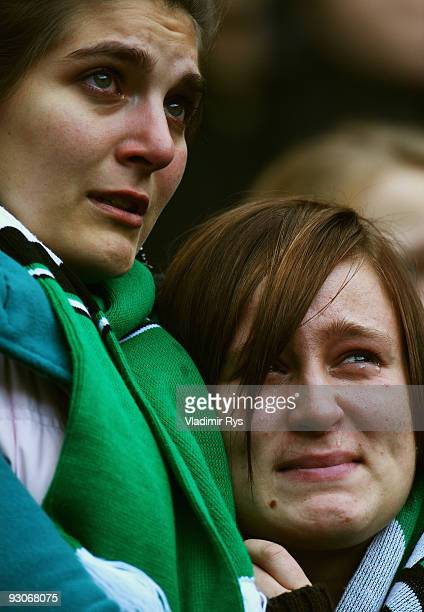 Female fans cry as members of the Hannover 96 football club carry the coffin of their goalie Robert Enke at a memorial service prior to Enke�s...