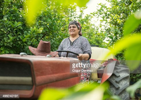 Female Farmer Driving Tractor Stock Photo | Getty Images