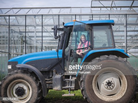 Female Farmer In Tractor On Herb Farm Foto stock | Getty ...