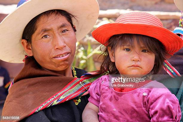 Female farmer with her child in a small village in the Andes on April 24 2016 in Tawarchapi Bolivia