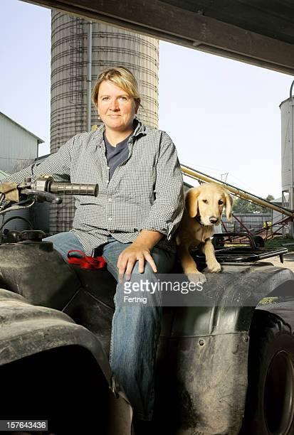 Female farmer with her dog on the farm