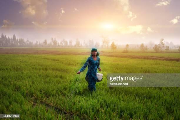 Female farmer working in the field