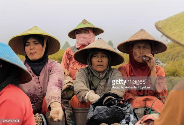 Female Farmers Wearing Asian Style Conical Hats At Farm