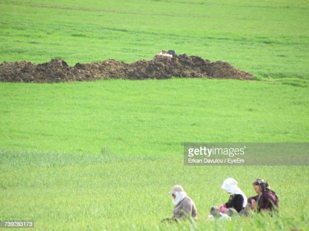 Female Farmers Working On Agricultural Field