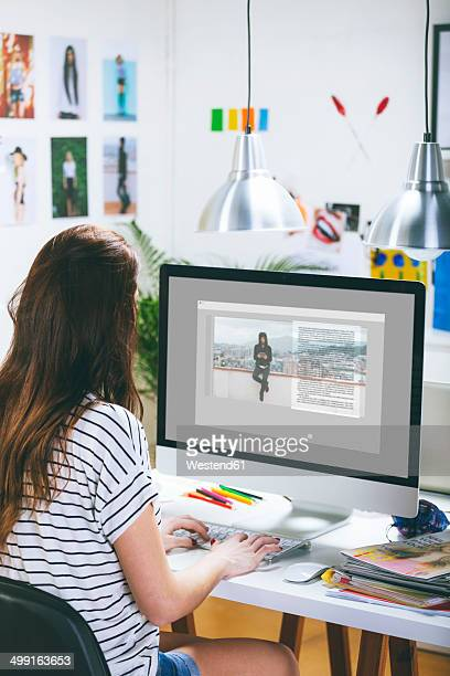 Female fashion blogger working at her office
