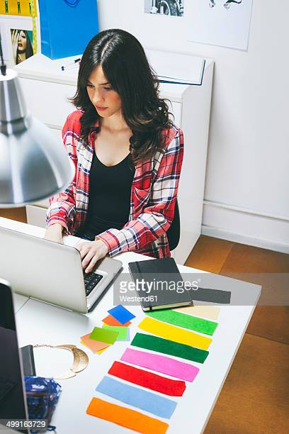 Female fashion bloggers working in her office, elevated view