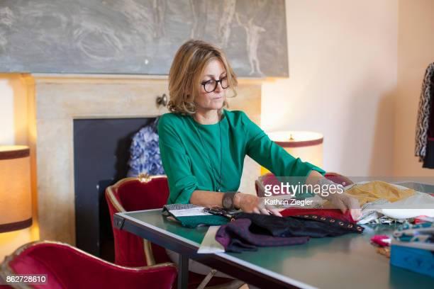 Female fashion designer at her work table