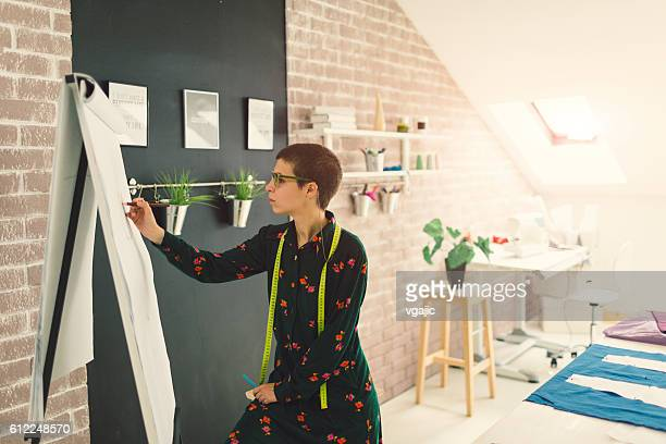 Female Fashion Designer Drawing