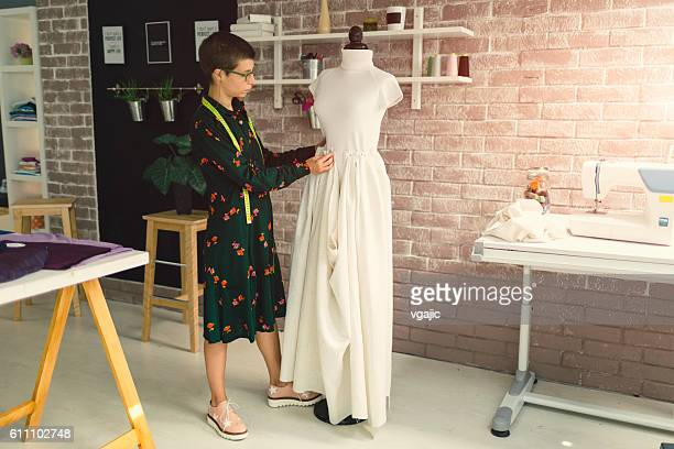 Female Fashion Designer In Her Workshop