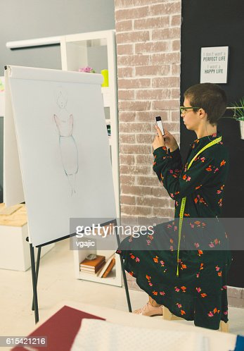 Female Fashion Designer In Her Workshop.