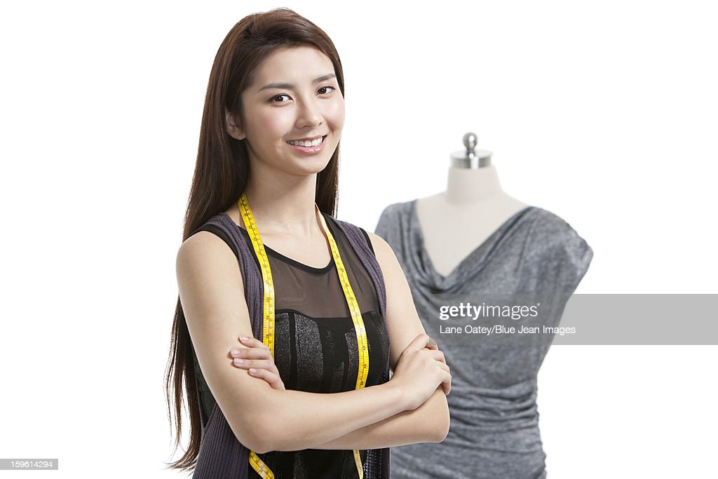 Female fashion designer with her works