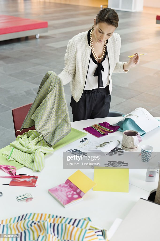 Female fashion designer working in an office : Stock Photo