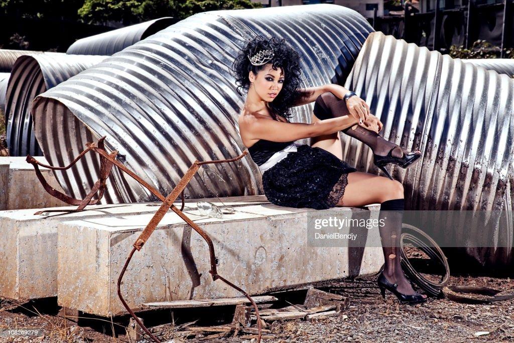 Female Fashion Model Posing in Scrap Metal Yard : Stock Photo