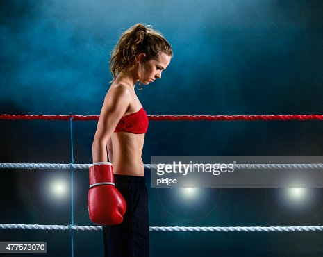 Female fighter concentrating before fight