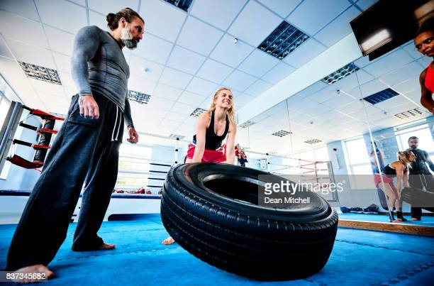 Female fighter during intense workout session in gym